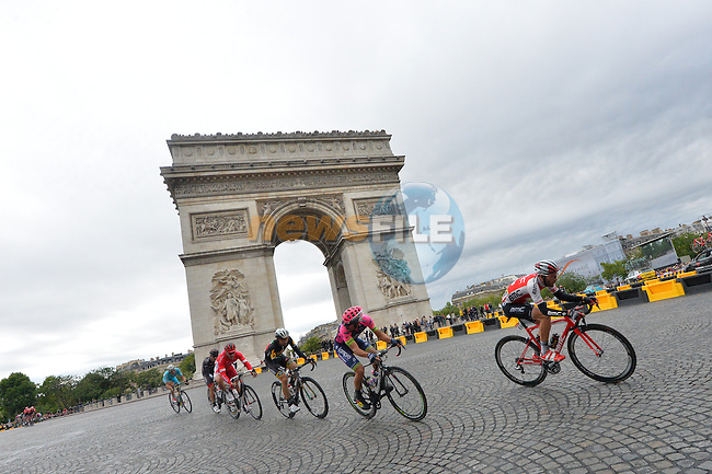 6 riders out front pass the Arc de Triomphe on the Champs Elysees in Paris during Stage 21 of the 2015 Tour de France running 109.5km from Sevres to Paris - Champs Elysees, France. 26th July 2015.<br /> Photo: ASO/B.Bade/Newsfile
