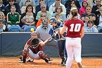 11 February 2012:  FIU's Kayla Burri (7) hits as the University of Massachusetts Minutewomen defeated the FIU Golden Panthers, 3-1, as part of the COMBAT Classic Tournament at the FIU Softball Complex in Miami, Florida.