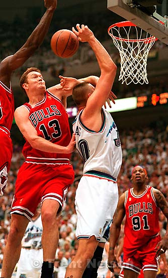Chicago's Luc Longley hammers Utah's Greg Ostertag at the NBA Finals Game four, Utah Jazz vs Chicago Bulls.<br />
