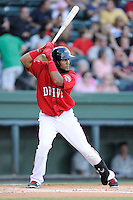 Second baseman Wendell Rijo (11) of the Greenville Drive bats in a game against the Lexington Legends on Sunday, August 31, 2014, at Fluor Field at the West End in Greenville, South Carolina. Rijo is the No. 18 prospect of the Boston Red Sox, according to Baseball America. Greenville won, 3-2. (Tom Priddy/Four Seam Images)