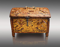 Gothic box made from poplar wood with stucco reliefs, gold leaf gold decorations and traces of polychrome iron and brass 2nd quarter 15th century, possibly from Barcelona, Catalunya, Spain. National Museum of Catalan Art, Barcelona, Spain, inv no: MNAC 12120. Against a light grey background.