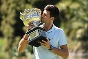 28th January 2019, Melbourne, Australia; 2019 Australian Open Champion, Novak Djokovic of Serbia, poses for photographs with the Championship trophy (Norman Brookes Challenge Cup) at the Royal Botanical Gardens in Melbourne, Australia on Jan. 28, 2019.