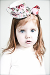 Close up of young girl wearing teacup headress