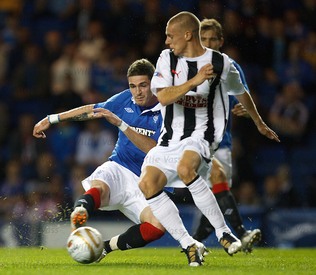 Kyle Lafferty blasts in goal no 2 for Rangers as Dunfermilne defender Callum Woods looks on