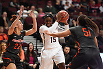 March 5, 2015; Las Vegas, NV, USA; Loyola Marymount Lions forward Emily Ben-Jumbo (15) controls the basketball against Pepperdine Waves guard Allie Green (22) and guard/forward Keitra Wallace (51) during the first half of the WCC Basketball Championships at Orleans Arena.