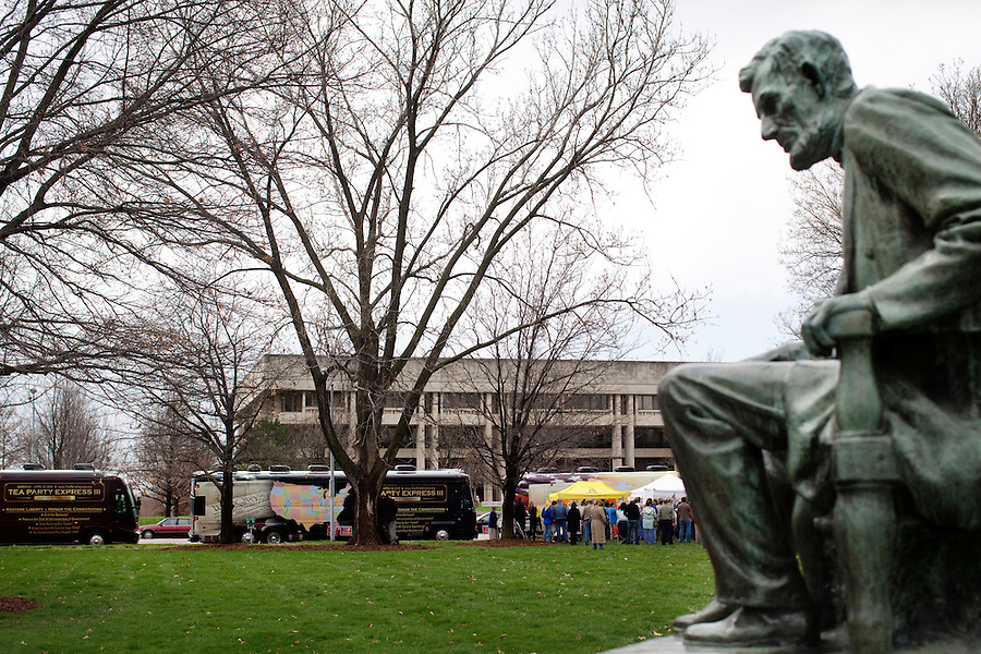 Topeka, Kansas, April 2, 2010 - A statue of Abraham Lincoln on the Capitol lawn where Tea Party supporters braved inclement weather to attend a Tea Party Express rally on the Capitol steps. The tour which began in Searchlight, NV, hometown of Senate Majority Leader Harry Reid, will wind through the 43 cities across the United States ending up in Washington, D.C. on April 15 for a tax day rally. Lincoln presided over one of the most defining moments in the country's history - the Civil War - when the country was deeply divided. .
