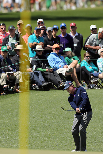 08.04.2016. Augusta, GA, USA - Tom Watson fires at the flag on the 2nd green during the second round of the 80th Masters at the Augusta National Golf Club, Friday, April 8, 2016 in Augusta, Ga