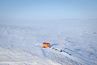Jeff King, Hugh Neff, Hans Gatt and Mitch Seavey wait out the Norton Bay 25 mph winds in a shelter cabin 15 miles out of Shaktoolik on their way to Koyuk during Iditarod 2009