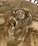 Architectural detail, musician with lute. Sicily, IT