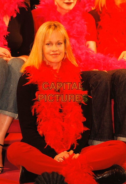 """MELANIE GRIFFITH.""""The Vagina Monologues"""" at The Old Vic, raising funds for six womens charities, London, UK..February 14th, 1999.Ref: JB.full length sitting legs crossed feather boa red.www.capitalpictures.com.sales@capitalpictures.com.©Jonathan Buckmaster/Capital Pictures"""