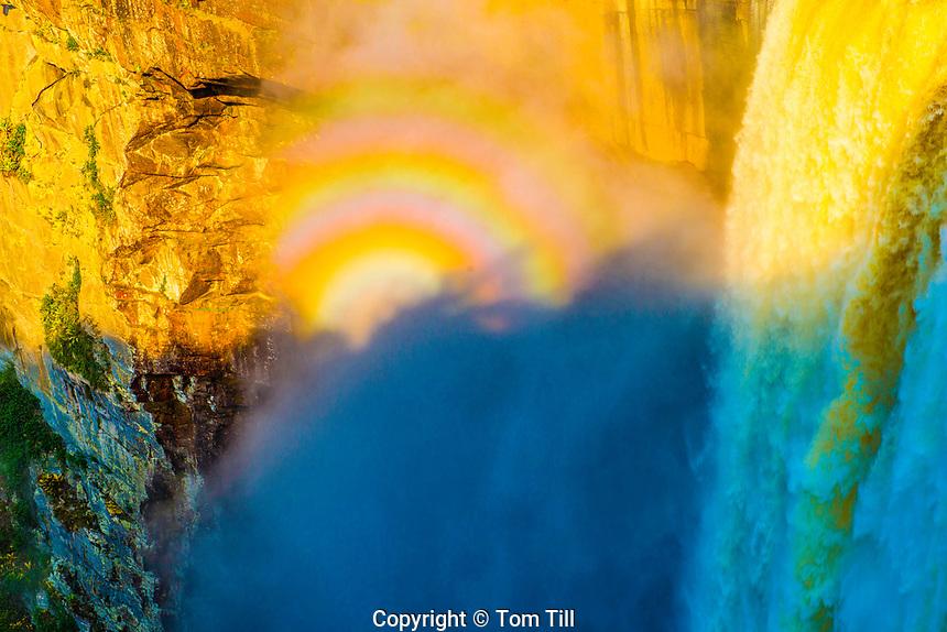 """Glory"" rainbows, Kaieteur Falls, Kaieteur National Park, Guyana, Potato River, Combines huge volume of water    with 822 foot drop"