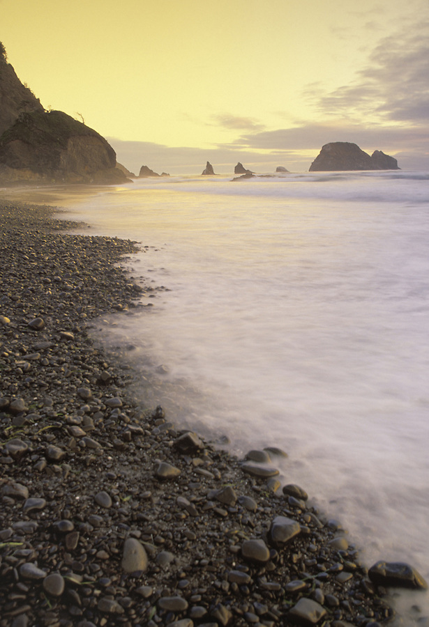Surf over beach pebbles, Oceanside, Oregon