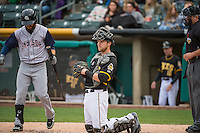 Jett Bandy (27) of the Salt Lake Bees on defense against the Colorado Springs Sky Sox in Pacific Coast League action at Smith's Ballpark on May 22, 2015 in Salt Lake City, Utah.  (Stephen Smith/Four Seam Images)