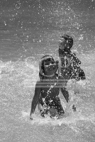 Xingu Indigenous Park, Mato Grosso State, Brazil. Aldeia Yawalapiti. Children enjoying the water.