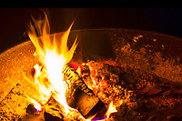 Camp fire in typical park fireplace use by state parks and Forest Service.