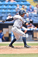 Charleston RiverDogs catcher Eduardo Navas (17) swings at a pitch during a game against the Asheville Tourists at McCormick Field on July 10, 2016 in Asheville, North Carolina. The Tourists defeated the RiverDogs 4-2. (Tony Farlow/Four Seam Images)