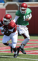 NWA Democrat-Gazette/ANDY SHUPE<br /> Arkansas quarterback Brandon Allen (10) hands the ball off Tuesday, Aug. 11, 2015, to running back Rawleigh Williams III during practice at the university's practice field in Fayetteville.
