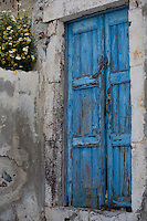 A weathered doorway of a residence in Oia town in northern Santorini, Cyclades Islands, Greece