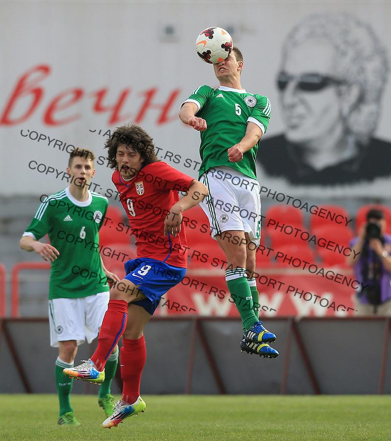 Fudbal UEFA U17 Elite round<br /> Srbija v Nemacka<br />  Benedikt Gimber (R) and Luka Jovic<br /> Novi Sad, 03.31.2014.<br /> Foto: Srdjan Stevanovic/Starsportphoto.com&copy;