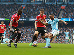 Raheem Sterling of Manchester City and Eric Bailly of Manchester United during the premier league match at the Etihad Stadium, Manchester. Picture date 7th April 2018. Picture credit should read: Simon Bellis/Sportimage