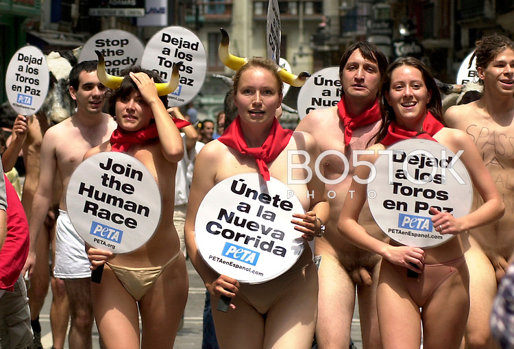 Animal rights protesters march on July 5th, 2002 in Pamplona against annual bull fighting and running of the bulls that are celebrated every year from July 7th through July 14th during the San Fermin festivities, Basque Country. On each day of the eight San Fermin festival days six bulls are released at 8:00 a.m. (0600 GMT) to run from their corral through the narrow, cobbled streets of the old navarre town over an 850-meter (yard) course. Ahead of them are the runners, who try to stay close to the bulls without falling over or being gored.  The demonstration was organized by the pro animal and anti bullfighting association People for the Ethical Treatment of Animals (PETA). (Ander Gillenea / Bostok Photo)