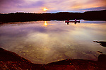 A couple of canoeists watch the sun set on another day in Quetico Provincial Park.