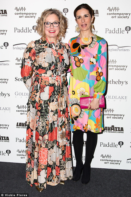 Caroline Douglas and Livia Giuggoili arrive for the Contemporary Art Society Fundraising Gala at Tobacco Dock in Wapping, East London on March 11, 2014.