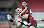 Dave Moore tackles Kieran Murphy..RaboDirect Pro12.Scarlets v Connacht.02.03.12.©STEVE POPE