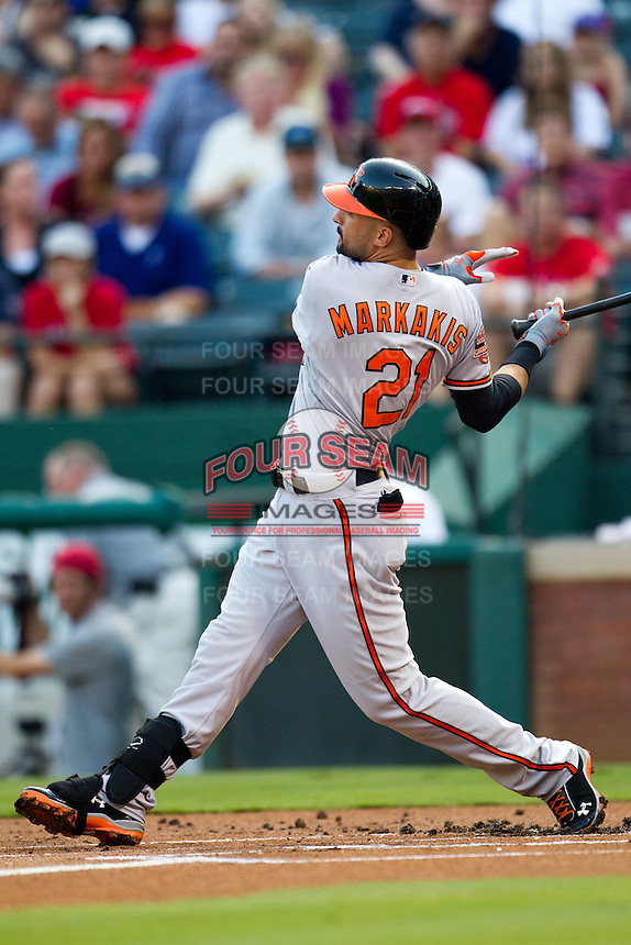 Baltimore Orioles outfielder Nick Markakis #21 swings during the Major League Baseball game against the Texas Rangers on August 21st, 2012 at the Rangers Ballpark in Arlington, Texas. The Orioles defeated the Rangers 5-3. (Andrew Woolley/Four Seam Images).
