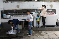 Blind and visually impaired Tibetan students do the washing up after breakfast at the School for the Blind in Tibet, in the capital city of Lhasa, September 2016.