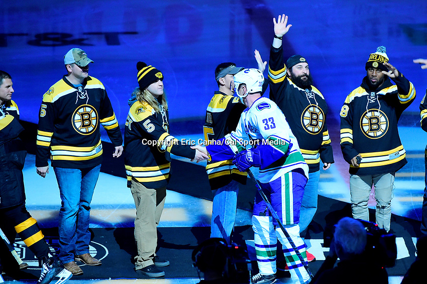 February 11, 2017: Vancouver Canucks center Henrik Sedin (33) shakes hands with New England Patriots assistant coach Steve Belichick before the National Hockey League game between the Vancouver Canucks and the Boston Bruins held at TD Garden, in Boston, Mass. Boston defeats Vancouver 4-3 in regulation time. Eric Canha/CSM