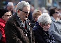 Pictured: A woman breaks down in tears during the minute's silence Friday 11 November 2016<br />