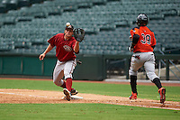 Arizona Diamondbacks pitcher Austin Byler (47) stretches for a throw as Gustavo Cabrera (39) runs to first during an instructional league game against the San Francisco Giants on October 16, 2015 at the Chase Field in Phoenix, Arizona.  (Mike Janes/Four Seam Images)