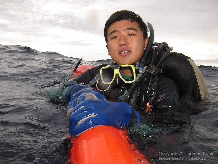 Qixingyan ('Seven Star Rock'), Taiwan -- Diver floating on his SMB, waiting to be picked up by the dive boat.