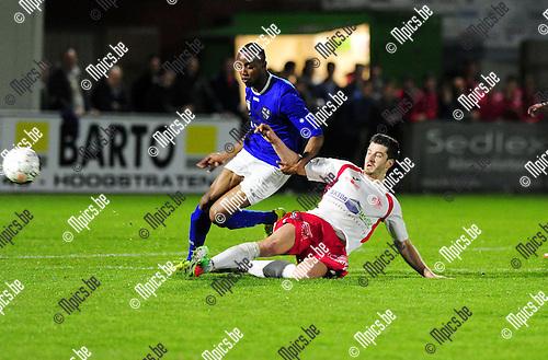 2015-04-25 / Voetbal / seizoen 2014-2015 / Hoogstraten VV - KV Turnhout / Jelle Van Kruijssen (Hoogstraten) probeert Kevin Bandundi Lilomba van de bal te zetten<br /><br />Foto: Mpics.be