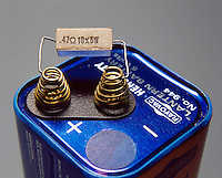 ELECTRICAL CIRCUIT WITH CERAMIC COIL RESISTOR<br /> Two Poles Of A Battery Are Connected By Resistor.