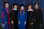 Left to right, the Rev. Dennis H. Holtschneider, C.M., president of DePaul, commencement speaker and honorary degree recipient John Corigliano, a Grammy Award-winning American composer, Elsa Rose Guenther, student speaker, Ronald Caltabiano, dean of the School of Music, and John Culbert, dean of The Theatre School. DePaul University School of Music and The Theatre School held its commencement ceremony, Saturday, June 10, 2017, during the DePaul University School of Music and The Theatre School commencement ceremony at the Rosemont Theatre in Rosemont, IL. (DePaul University/Jeff Carrion)