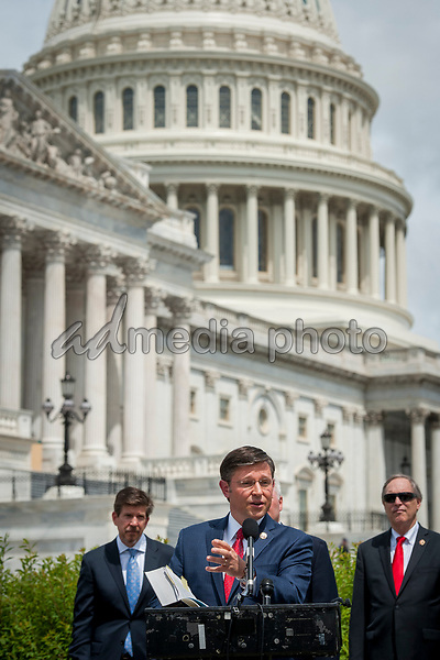 Rep. Mike Johnson (R-LA) offers remarks and holds a House Rules and Manual book as he joins House Minority Leader Rep. Kevin McCarthy (R-Calif.), House Minority Whip Rep. Steve Scalise (R-LA), House GOP Conference Chairwoman Liz Cheney (R-WY) and others, to announce that Republican leaders have filed a lawsuit against House Speaker Nancy Pelosi and congressional officials in an effort to block the House of Representatives from using a proxy voting system to allow for remote voting during the coronavirus pandemic, outside of the U.S. Capitol in Washington, DC., Wednesday, May 27, 2020. Credit: Rod Lamkey / CNP/AdMedia