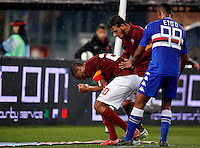 Calcio, Serie A: Roma vs Sampdoria. Roma, stadio Olimpico, 16 marzo 2015.<br /> Roma's Seydou Keita, left, is comforted by his teammate Alessandro Florenzi, center, and Sampdoria's Samuel Eto'o after receiving a red card during the Italian Serie A football match between Roma and Sampdoria at Rome's Olympic stadium, 16 March 2015.<br /> UPDATE IMAGES PRESS/Riccardo De Luca
