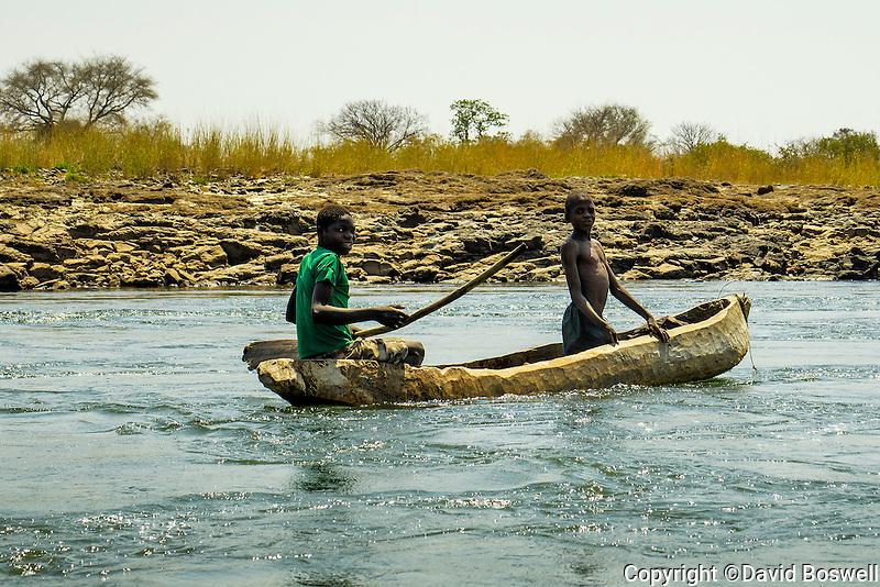 Boys in a Mokoro on the Zambezi River above Victoria Falls.