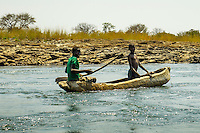Boys in a Mokoro on the Zambezi River above Victoria Falls.