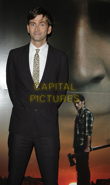 "David Tennant.""Fright Night"" UK premiere, Vue cinema, O2 Arena, Greenwich, London, England..August 14th, 2011.half length black suit white shirt yellow leopard print tie brown.CAP/CAN.©Can Nguyen/Capital Pictures."
