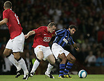 Manchester United's Wayne Rooney and Inter Milan's Luis Figo. Pic SPORTIMAGE/Dave Thompson..Pre-Season Friendly..Manchester United v Internazionale..1st August, 2007..--------------------..Sportimage +44 7980659747..admin@sportimage.co.uk..http://www.sportimage.co.uk/