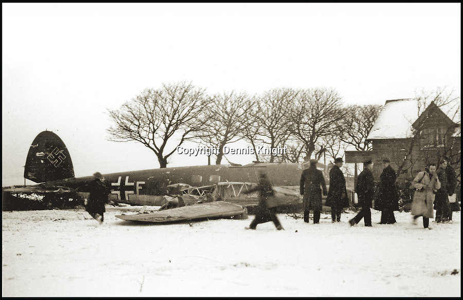 BNPS.co.uk (01202 558833)<br /> Pic: DennisKinght/BNPS<br /> <br /> The crash site of Heinkel He 111P at Whitby.<br /> <br /> An artistic historian has reconstructed hundreds of Battle of Britain aircraft losses in accurate drawings after spending years travelling the English countryside researching the wartime events.<br /> <br /> Dennis Knight visited villages where stricken RAF and Luftwaffe planes met their end and tracked down surviving eye-witnesses to get first hand accounts of the incidents.<br /> <br /> The 85 year old combined the testimonies and local records to help him accurately recreate the downfall of hundreds of World War Two bombers and fighter planes in his colourful drawings.