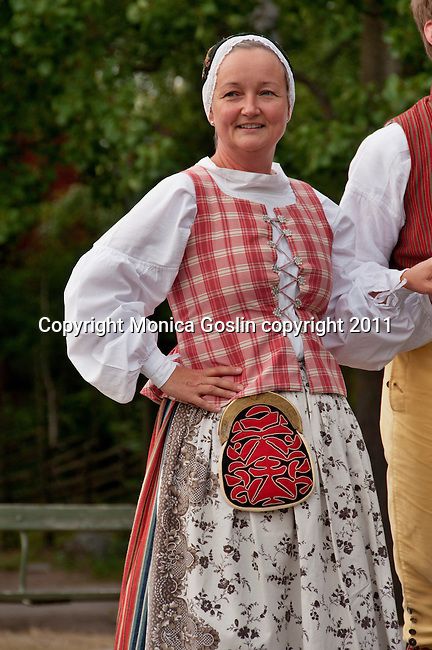 Folk dancers in Stockholm, Sweden performing at Skansen, a park full of traditional builings and farmsteads from all over Sweden