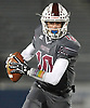 Michael Proios #10, Mepham quarterback, scrambles for a gain during the Nassau County Conference II varsity football semifinals against Carey at Hofstra University on Friday, Nov. 10, 2017.