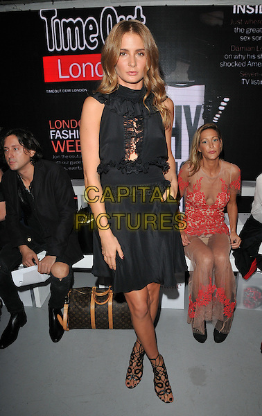 Carl Barat, Millie Mackintosh &amp; Laura Pradelska attend the PPQ LFW s/s 2016 catwalk show, The Vinyl Factory, Marshall Street, London, England, UK, on Friday 18 September 2015. <br /> CAP/CAN<br /> &copy;Can Nguyen/Capital Pictures