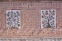 The beautiful western wall of the Jagyeongjeon, built in the fifteenth century, is decorated with designs of peaches, chrysanthemums, bamboos, butterflies and lotuses. Jagyeongjeon was the living quarters of the Queen Dowager Jo, the mother of King Hyeongjong (r. 1834-1848) and is in the grounds of Gyeongbokgung, or the Palace of Shining Happiness.