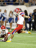 Manatee Hurricanes kicker Nick Tankersley #14 kicks a field goal with no time left in the second quarter after a penalty during the Florida High School Athletic Association 7A Championship Game at Florida's Citrus Bowl on December 16, 2011 in Orlando, Florida.  The score at halftime is Manatee 17 - First Coast 0.  (Mike Janes/Four Seam Images)