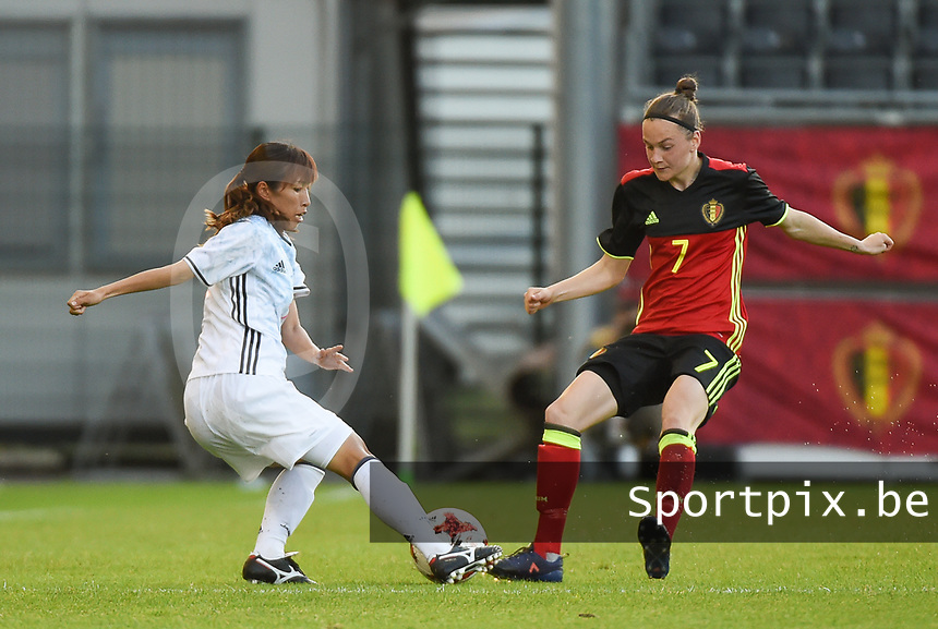 20170613 - LEUVEN ,  BELGIUM : Belgian Elke Van Gorp (R) and Japanese Emi Nakajima (L) pictured during the female soccer game between the Belgian Red Flames and Japan , a friendly game before the European Championship in The Netherlands 2017  , Tuesday 13 th Juin 2017 at Stadion Den Dreef  in Leuven , Belgium. PHOTO SPORTPIX.BE | DIRK VUYLSTEKE